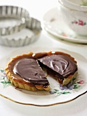 Butterscotch tartlet topped with salted chocolate