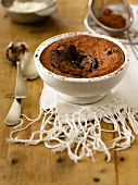 Chocolate & caramel pudding dusted with cocoa powder