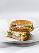 Grilled Ham and Cheese Sandwich with Arugula; Halved and Stacked