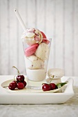 Cherry and vanilla ice cream with macaroons and vanilla and chocolate sauce