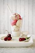 Cherry and vanilla ice cream with macaroons and vanilla and chocolate sauce