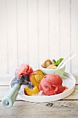 Nectarine and plum sorbet with mini doughnuts