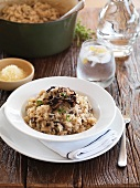 Mushroom risotto, iced water and grated Parmesan