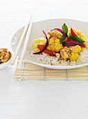Sate chicken with cauliflower on a bed of rice (Asia)