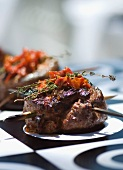 Mediterranean lamb steak served with dried tomatoes