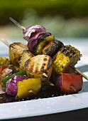 Grilled vegetable skewers and potato skewers