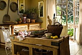 Kitchen utensils, lemons, baguette and lavender on a rustic wooden table