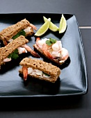 Finger sandwiches with prawns, mayonnaise and coriander
