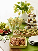 Appetizer Table with Tiered Cupcake Stand