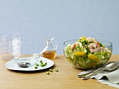 Shrimp and Pea Salad in a Serving Bowl; Dressing and Bowls