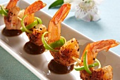Fried prawn kebabs with limes and a tamarind sauce