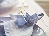 A light-blue place setting in country house style