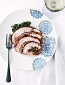 Rolled roasted turkey with pancetta, walnuts and parsley