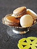 Macaroons filled with chocolate and coconut cream in a silver dish