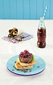 Lamb burger with mint sauce and beetroot tzatziki, served with aubergine chips and a soft drink