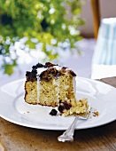 A slice of blueberry butter cake on a plate