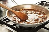 Making Mushroom Wine Sauce in a Skillet