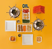 Utensils and ingredients for a fondue with oil (view from above)