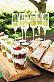 Brunch outdoors with sparkling wine, crispy muesli and sweet wraps