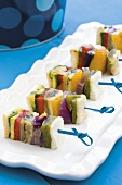 Colourful vegetable skewers with fish