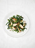 Salad of green vegetables with chicken breast and pesto