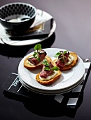 Toasted slices of bread with wasabi paste and roast beef