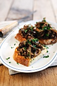 Crostini topped with chicken liver and onions