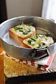 Toast topped with green asparagus, gorgonzola and mozzarella