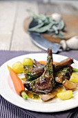 Lamb chops with potatoes, carrots and a parsley and mustard sauce