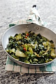 Fried chicory greens with chilli and garlic