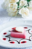 Heart-shaped berry mousse with vanilla jelly