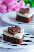 Heart-shaped chocolate cake topped with coconut and vanilla jelly