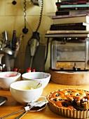 Dried plum tart in a kitchen