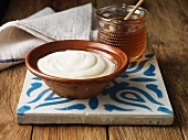 Greek yogurt and honey on tile