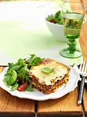 Lasagne with minced beef on a wooden table