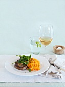 Pork fillet with mashed carrot and parsnip