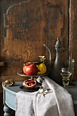 Autumn still life with pomegranates and a quince