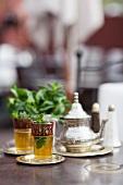 Glasses of mint tea on table
