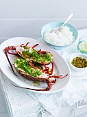 Steamed lobsters with ginger