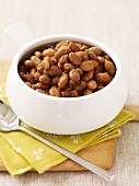 Bowl of Baked Beans with a Spoon