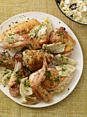 Platter of Chicken Pieces with Onions and Fresh Herbs