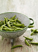 Fresh Washed Snap Peas in a Colander