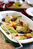 Baked fennel with dried tomatoes and olives