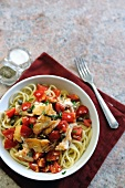 Spaghetti with haddock, tomatoes and capers (seen from above)