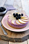 Blackberry and cream cheese cake topped with blackberries and pears
