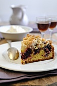 A slice of blackberry and apple crumble cake