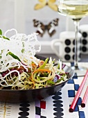 Bowl of Asian Salad with Red Chopsticks