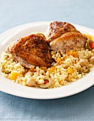 Spicy Roasted Chicken on a Bed of Couscous with Garbanzo Beans and Green Olives
