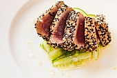 Sesame Encrusted Seared Ahi Tuna in a Spicy Cucumber and Lime Vinaigrette