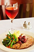 Sliced Duck Breast with Cherries, Mashed Potato and Mixed Vegetables
